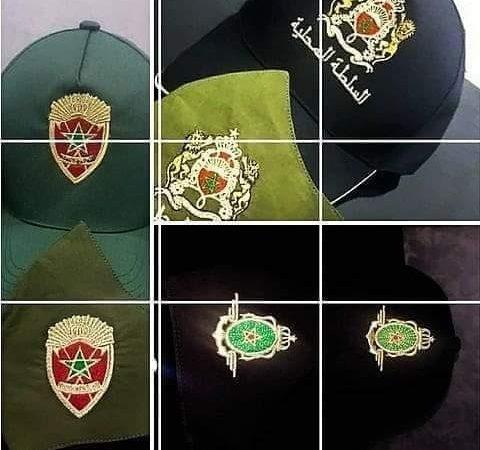 إيقاف سيدة متلبسة بحيازة قبعات وكمامات تحمل شارات مزورة للقوات العمومية